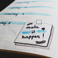 A page of a diary with make it happen written on the page